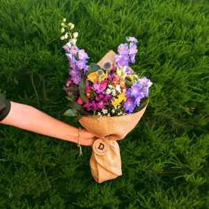 Colourful medium sized bouquet on green background