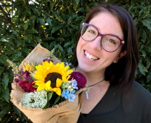 Dope founder Delanie Schulte with bouquet of flowers