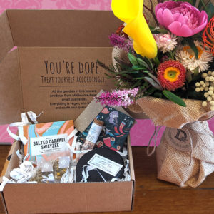 photo of a bouquet of flowers and a gift box of goodies!