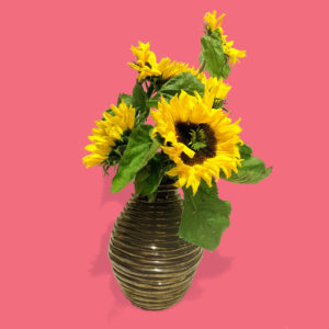 chunky gold vase with sunflowers